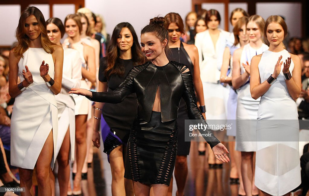 Miranda Kerr greets Dion Lee as she showcases designs by Dion Lee on the catwalk during the David Jones A/W 2013 Season Launch at David Jones Castlereagh Street on February 6, 2013 in Sydney, Australia.