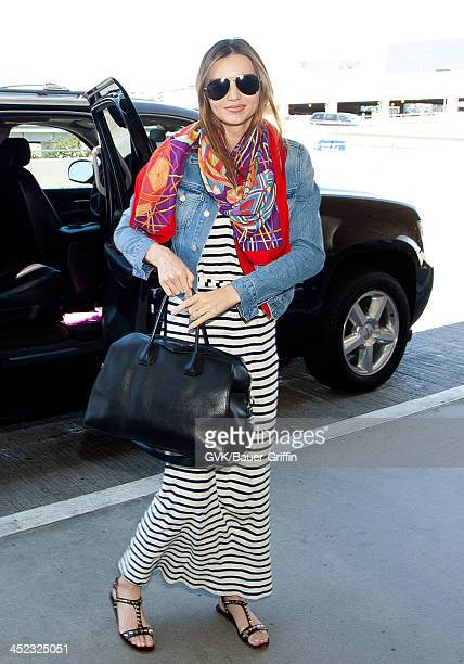 Miranda Kerr is seen as she prepares to depart from LAX on August 22 2013 in Los Angeles California