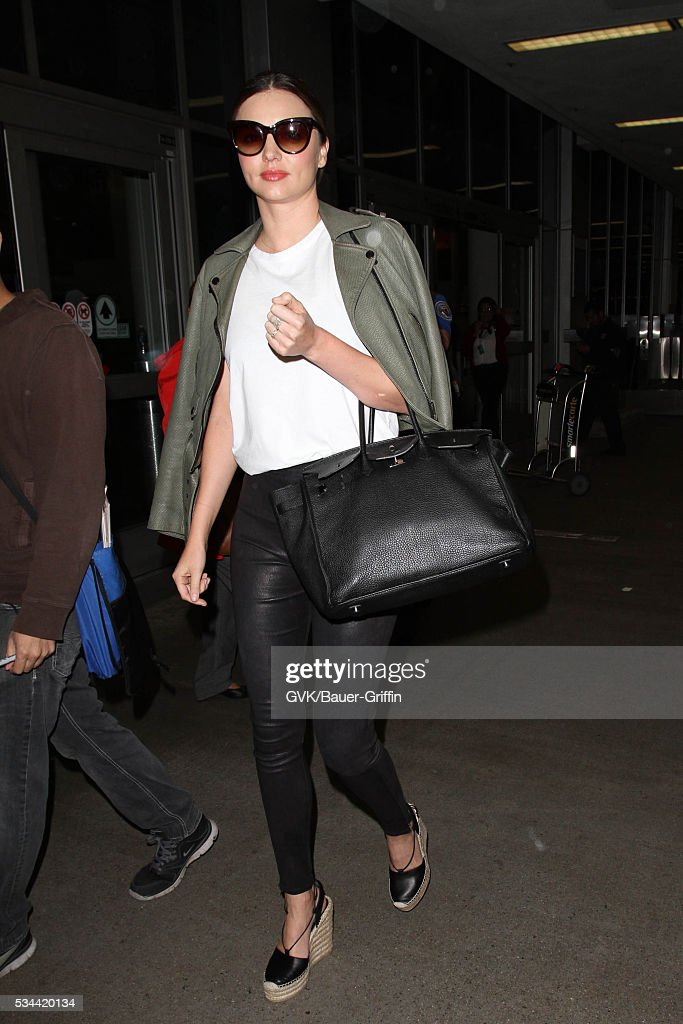 <a gi-track='captionPersonalityLinkClicked' href=/galleries/search?phrase=Miranda+Kerr&family=editorial&specificpeople=5714330 ng-click='$event.stopPropagation()'>Miranda Kerr</a> is seen at LAX on May 26, 2016 in Los Angeles, California.