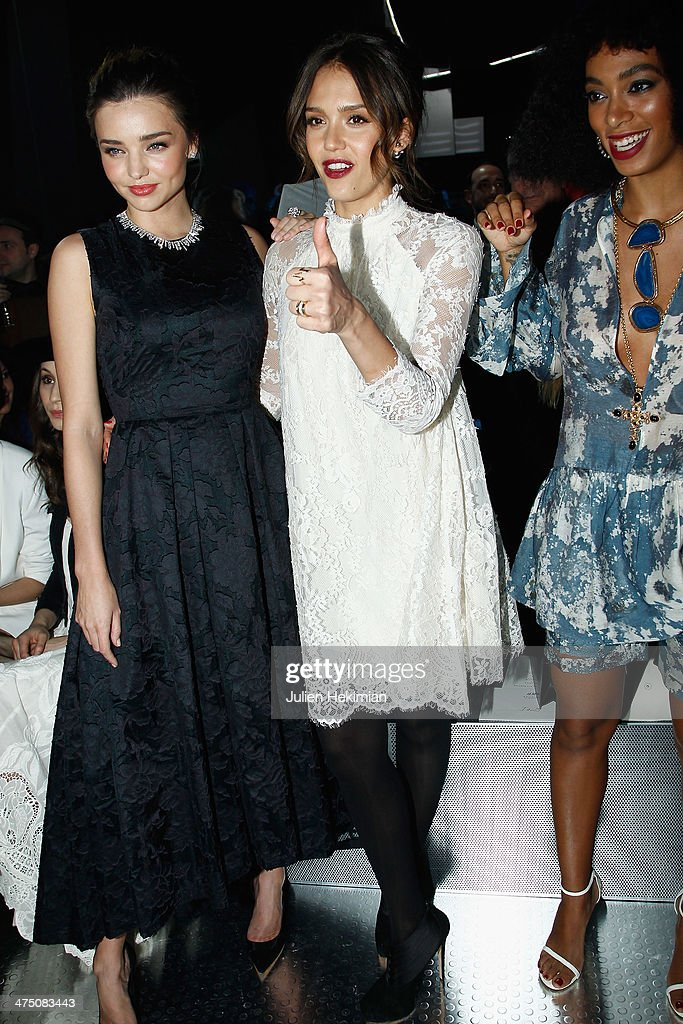 Miranda Kerr, Jessica Alba and Solange Knowles attend the H&M show as part of the Paris Fashion Week Womenswear Fall/Winter 2014-2015 on February 26, 2014 in Paris, France.