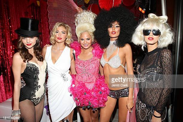 Miranda Kerr Kate Upton Christine Teigen Nicole Trunfino and Jaslene Gonzalez attends Miranda Kerr's Sexy Circus Halloween Party at Catch Rooftop on...