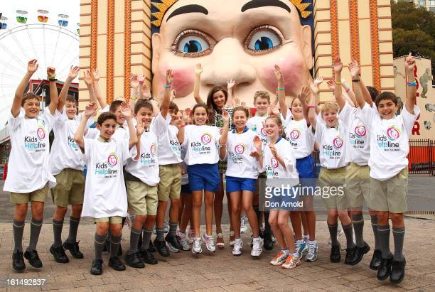 Miranda Kerr poses alongside children after being named Kids Helpline ambassador at Luna Park on February 12 2013 in Sydney Australia Kids Helpline...
