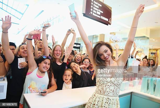 Miranda Kerr poses alongside fans at Westfield Bondi Junction on December 17 2015 in Sydney Australia