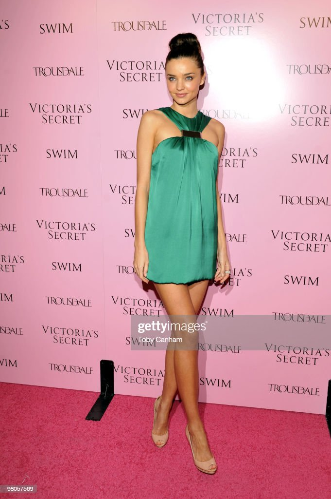 Miranda Kerr poses for a picture at the 15th Anniversary of Victoria's Secret SWIM catalogue held at Trousdale on March 25, 2010 in Los Angeles, California.