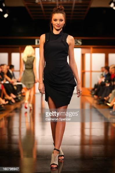 Miranda Kerr showcases designs by Camilla and Marc on the runway during the David Jones A/W 2013 Season Launch at David Jones Castlereagh Street on...
