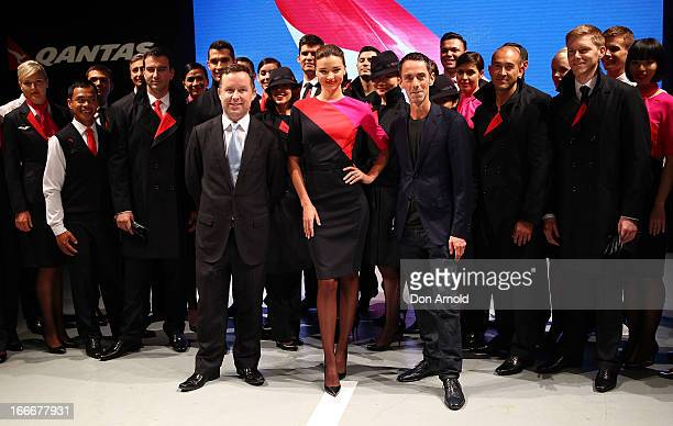 Miranda Kerr showcases the Qantas uniform alongside Qantas staff Alan Joyce and designer Martin Grant during the Qantas uniform unveiling at Hordern...