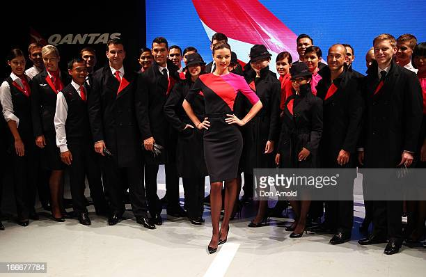 Miranda Kerr showcases the Qantas uniform alongside Qantas staff during the Qantas uniform unveiling at Hordern Pavilion on April 16 2013 in Sydney...
