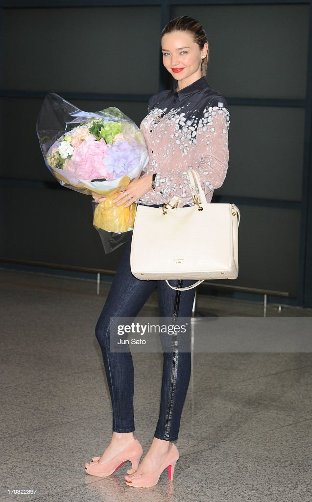 <a gi-track='captionPersonalityLinkClicked' href=/galleries/search?phrase=Miranda+Kerr&family=editorial&specificpeople=5714330 ng-click='$event.stopPropagation()'>Miranda Kerr</a> sighted upon arrival at Incheon International Airport on June 11, 2013 in Incheon, South Korea.