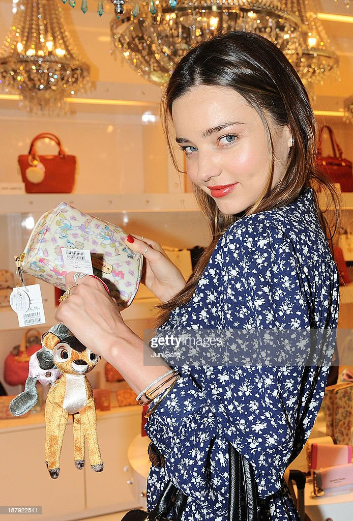 <a gi-track='captionPersonalityLinkClicked' href=/galleries/search?phrase=Miranda+Kerr&family=editorial&specificpeople=5714330 ng-click='$event.stopPropagation()'>Miranda Kerr</a> visits Samantha Thavasa shop at Narita International Airport on November 14, 2013 in Narita, Japan.