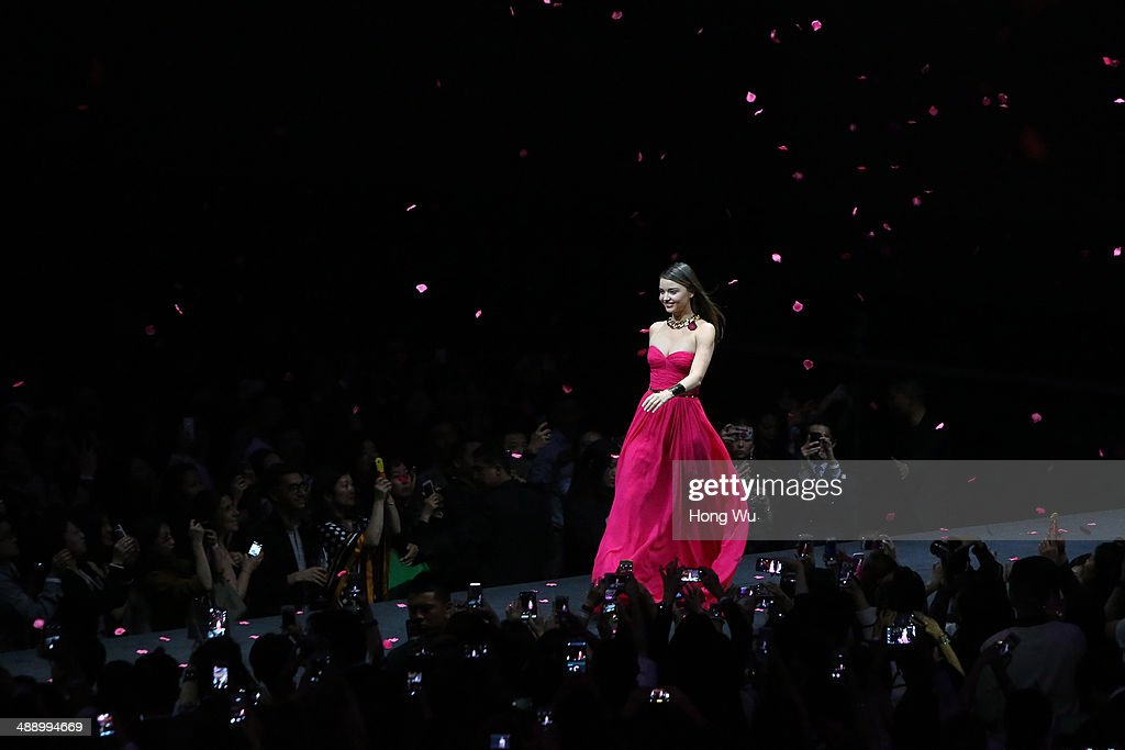Miranda Kerr walks on the catwalk during The Michael Kors Jet Set Experience fashion show on May 9, 2014 in Shanghai, China.