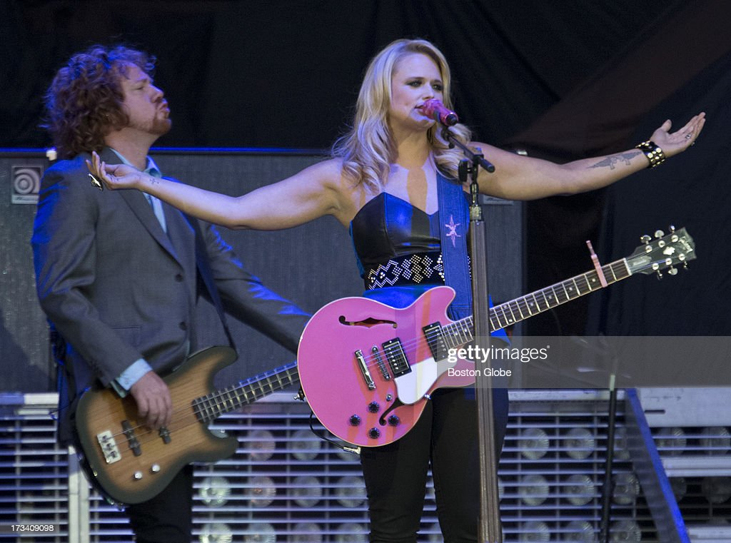 Miranda Lambert and bass player Aden Bubeck during the opening act for Jason Aldean in concert at Fenway Park, Friday, July 12, 2013.