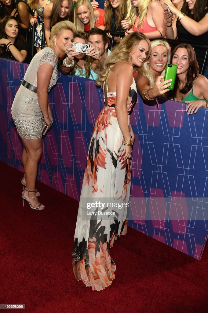 <a gi-track='captionPersonalityLinkClicked' href=/galleries/search?phrase=Miranda+Lambert&family=editorial&specificpeople=571972 ng-click='$event.stopPropagation()'>Miranda Lambert</a> (L) and <a gi-track='captionPersonalityLinkClicked' href=/galleries/search?phrase=Carrie+Underwood&family=editorial&specificpeople=204483 ng-click='$event.stopPropagation()'>Carrie Underwood</a> attend the 2014 CMT Music awards at the Bridgestone Arena on June 4, 2014 in Nashville, Tennessee.