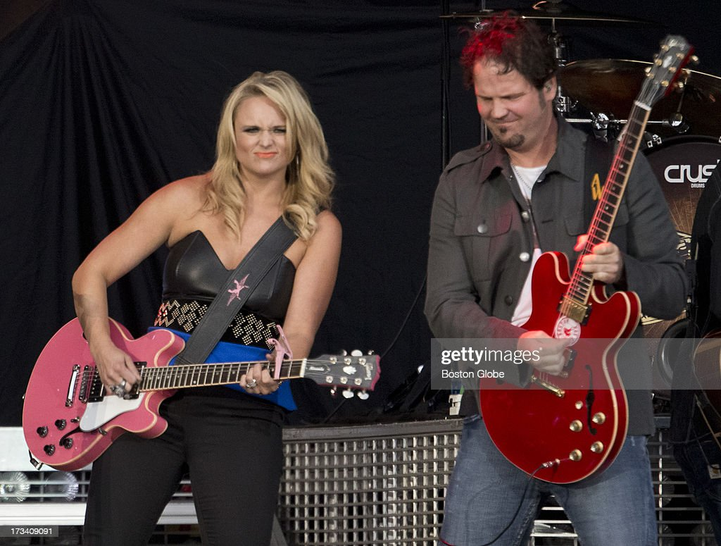 Miranda Lambert and guitarist Alex Weeden during the opening act for Jason Aldean in concert at Fenway Park, Friday, July 12, 2013.