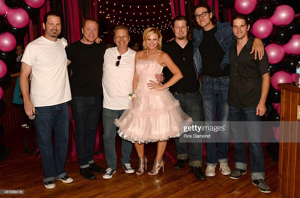 <a gi-track='captionPersonalityLinkClicked' href=/galleries/search?phrase=Miranda+Lambert&family=editorial&specificpeople=571972 ng-click='$event.stopPropagation()'>Miranda Lambert</a> (C) and her bandmates attend the 'Automatic' No. 1 party on June 30, 2014 in Nashville, Tennessee.