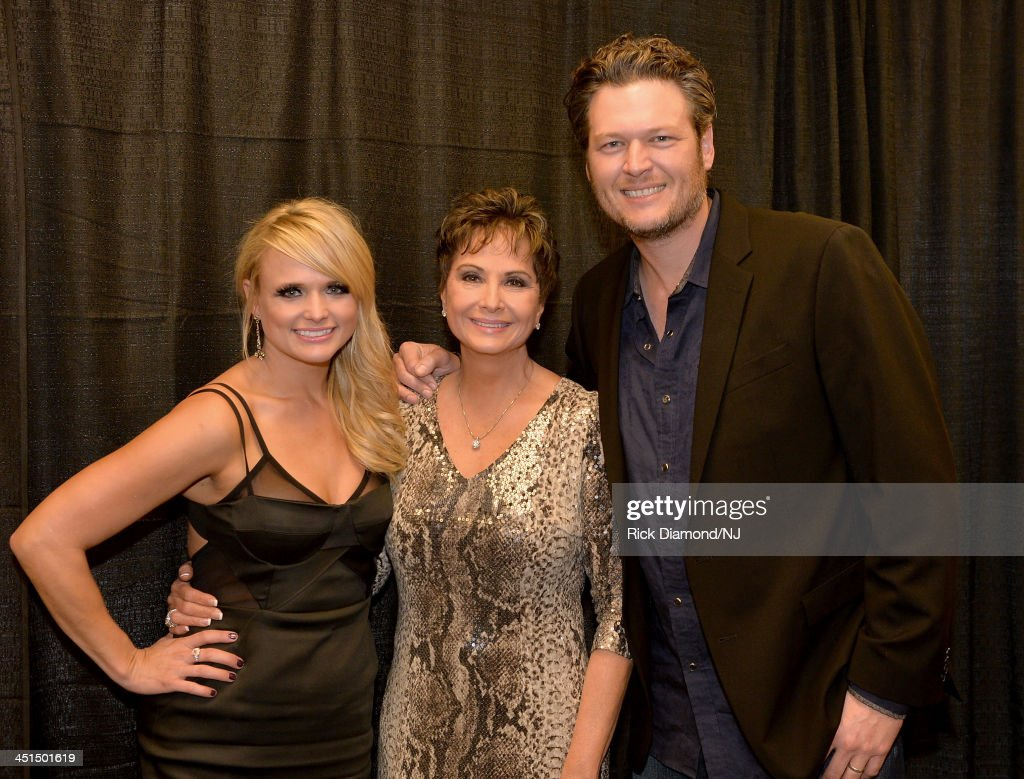 <a gi-track='captionPersonalityLinkClicked' href=/galleries/search?phrase=Miranda+Lambert&family=editorial&specificpeople=571972 ng-click='$event.stopPropagation()'>Miranda Lambert</a>, Nancy Jones, and <a gi-track='captionPersonalityLinkClicked' href=/galleries/search?phrase=Blake+Shelton&family=editorial&specificpeople=2352026 ng-click='$event.stopPropagation()'>Blake Shelton</a> attend Playin' Possum! The Final No Show Tribute To George Jones at Bridgestone Arena on November 22, 2013 in Nashville, Tennessee.
