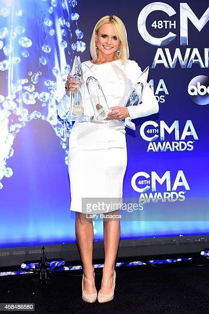 Miranda Lambert poses in the press room with her awards at the 48th annual CMA Awards at the Bridgestone Arena on November 5 2014 in Nashville...