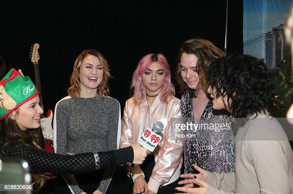 Miranda Miller Rena Lovelis Casey Moreta and Nia Lovelis of the band Hey Violet are being interviewed as they attend the Z100 CocaCola All Access...