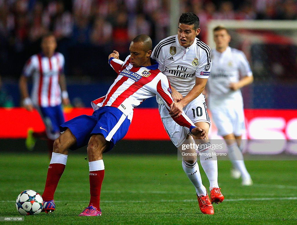 Miranda of Atletico Madrid and James Rodriguez of Real Madrid CF battle for the ball during the UEFA Champions League Quarter Final First Leg match...