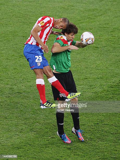 Miranda of Atletico Madrid competes with Fernando Llorente of Athletic Bilbao during the UEFA Europa League Final between Atletico Madrid and...