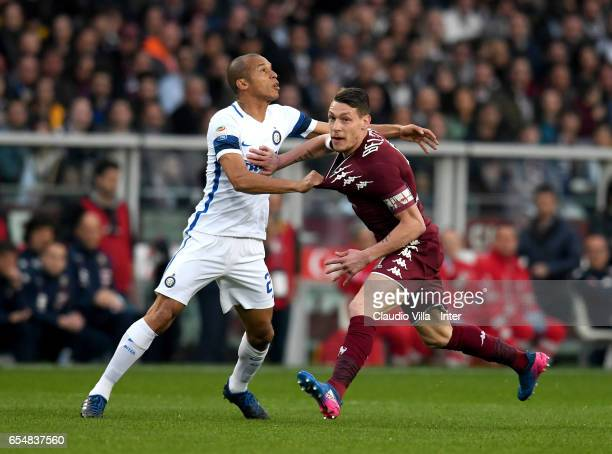 Miranda of FC Internazionale and Andrea Belotti of FC Torino compete for the ball during the Serie A match between FC Torino and FC Internazionale at...