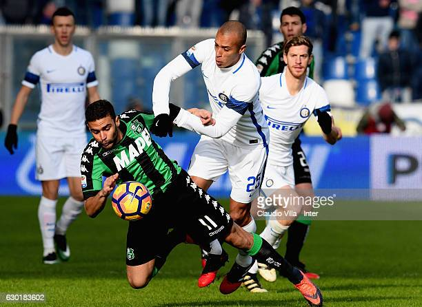 Miranda of FC Internazionale and Gregoire Defrel of US Sassuolo Calcio compete for the ball during the Serie A match between US Sassuolo and FC...