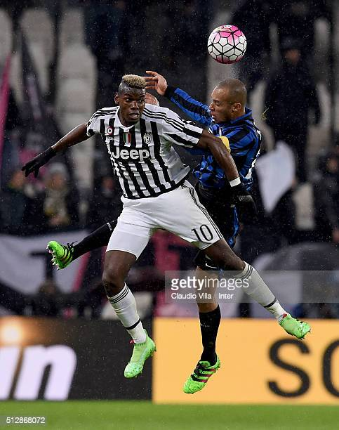 Miranda of FC Internazionale and Paul Pogba of Juventus compete for the ball during the Serie A match between Juventus FC and FC Internazionale...