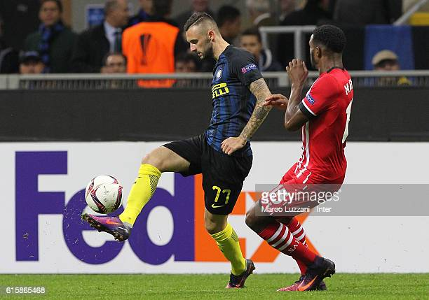 Miranda of FC Internazionale competes for the ball with Cuco Martina of Southampton FC during the UEFA Europa League match between FC Internazionale...