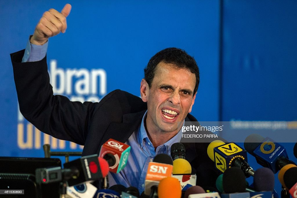 Miranda state governor and opposition leader Henrique Capriles Radonski speaks during a press conference in Caracas on January 14, 2015. The Venezuelan opposition leader Henrique Capriles announced Wednesday that the opposition coalition Mesa de la Union Democrática (MUD) will be reorganized in vue of the economic crisis and facing the legislative elections of 2015.