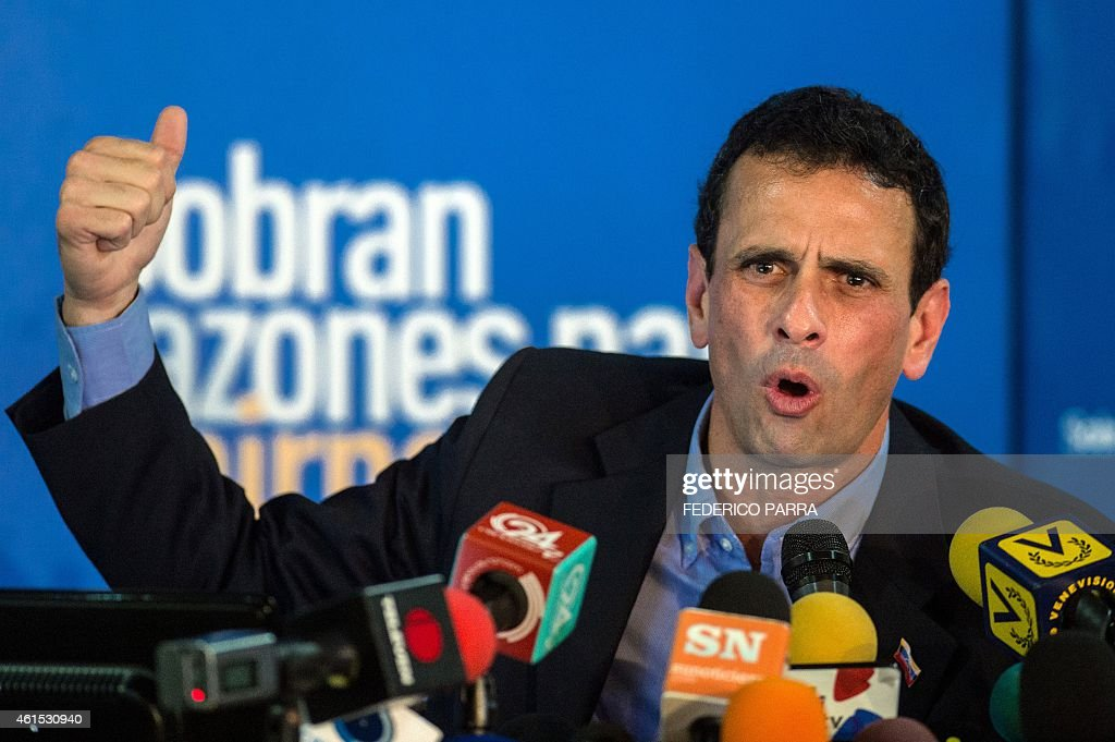 Miranda state governor and opposition leader <a gi-track='captionPersonalityLinkClicked' href=/galleries/search?phrase=Henrique+Capriles+Radonski&family=editorial&specificpeople=7216561 ng-click='$event.stopPropagation()'>Henrique Capriles Radonski</a> speaks during a press conference in Caracas on January 14, 2015. The Venezuelan opposition leader Henrique Capriles announced Wednesday that the opposition coalition Mesa de la Union Democrática (MUD) will be reorganized in vue of the economic crisis and facing the legislative elections of 2015.