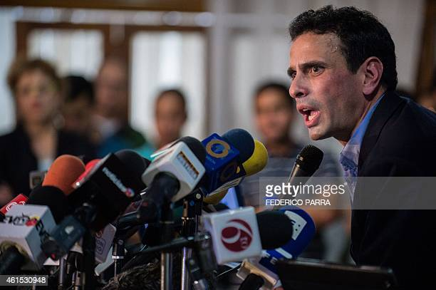 Miranda state governor and opposition leader Henrique Capriles Radonski speaks during a press conference in Caracas on January 14 2015 The Venezuelan...