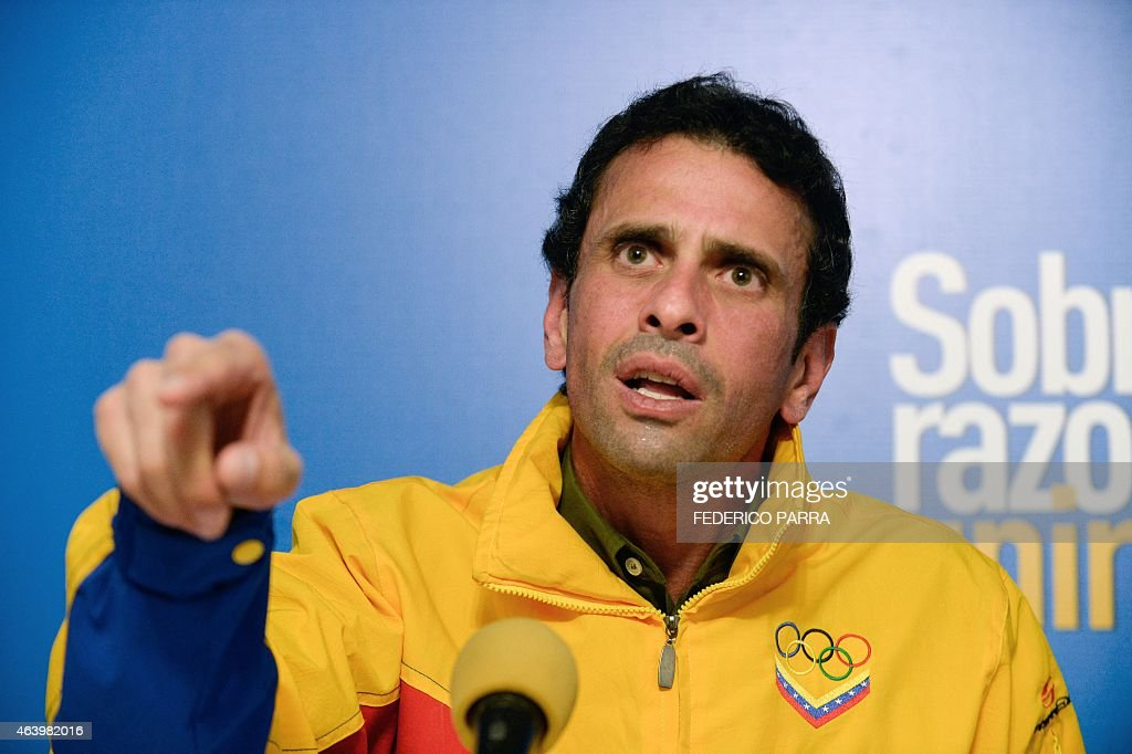 Miranda state governor and opposition leader Henrique Capriles speaks during a press conference in Caracas on February 20, 2015. The United States and Latin American nations voiced concerns Friday over political tensions in Venezuela after the socialist government arrested the opposition mayor of Caracas over an alleged coup plot. AFP PHOTO/FEDERICO PARRA
