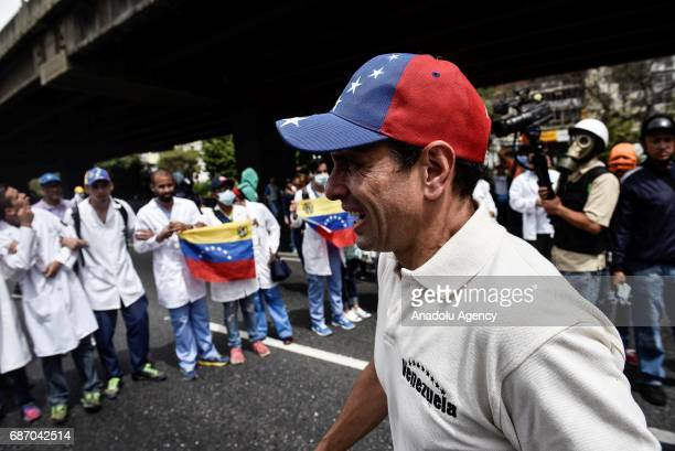 Miranda's Governor Henrique Capriles affected by tear gas during a march by doctors and other health care personnel in Caracas Venezuela on May 22...