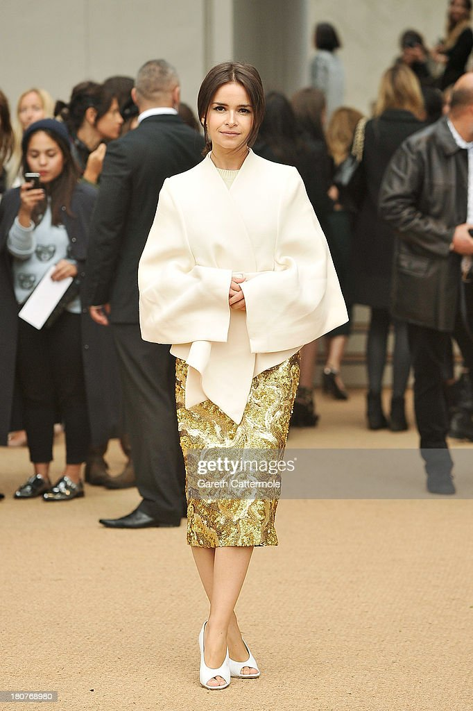 Miraoslava Duma arrives at Burberry Prorsum Womenswear Spring/Summer 2014 show during London Fashion Week at Kensington Gardens on September 16, 2013 in London, England.