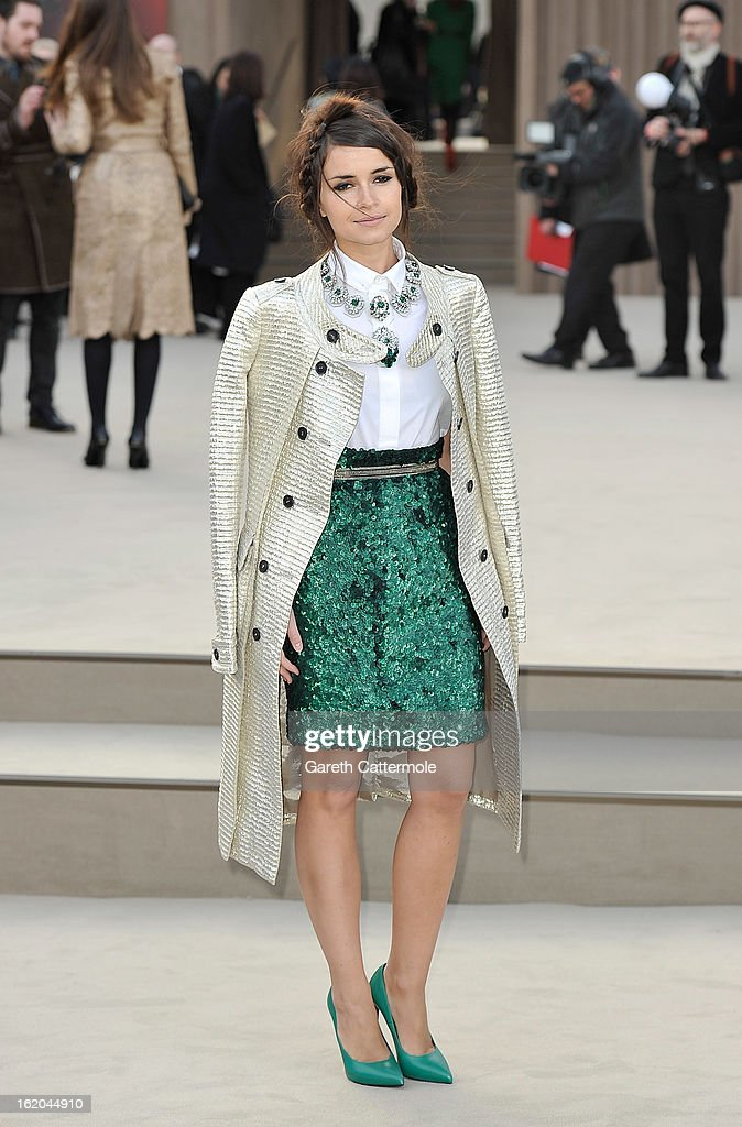 Miraoslava Duma, wearing Burberry, arrives at the Burberry Prorsum Autumn Winter 2013 Womenswear Show on February 18, 2013 in London, England.