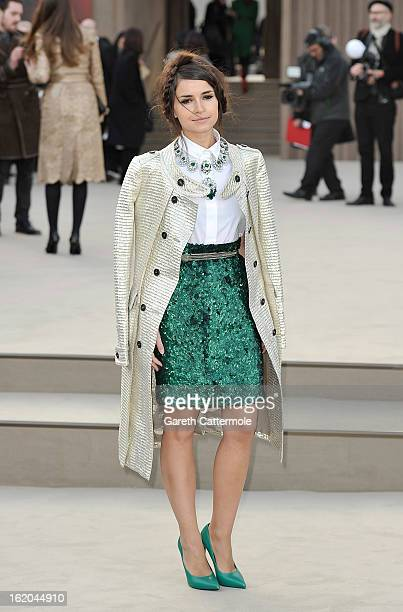 Miraoslava Duma wearing Burberry arrives at the Burberry Prorsum Autumn Winter 2013 Womenswear Show on February 18 2013 in London England