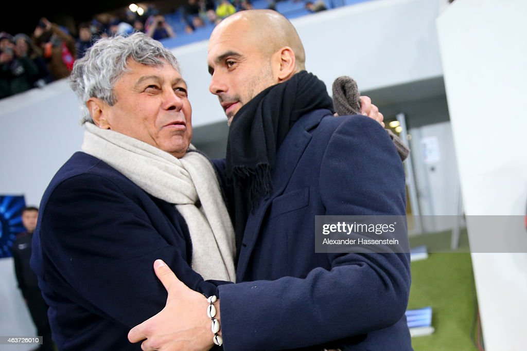 <a gi-track='captionPersonalityLinkClicked' href=/galleries/search?phrase=Mircea+Lucescu&family=editorial&specificpeople=5511022 ng-click='$event.stopPropagation()'>Mircea Lucescu</a>, head coach of Shakhtar Donetsk reacts with <a gi-track='captionPersonalityLinkClicked' href=/galleries/search?phrase=Josep+Guardiola&family=editorial&specificpeople=2088964 ng-click='$event.stopPropagation()'>Josep Guardiola</a>, head coach of Muenchen prior to the UEFA Champions League round of 16 first leg match between FC Shakhtar Donetsk and FC Bayern Muenchen at Arena Lviv on February 17, 2015 in Lviv, Ukraine.