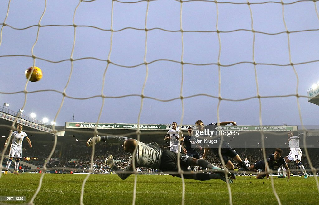 Mirco Antenucci of Leeds shoots past Lee Grant, Goalkeeper of Derby County for the opening goal during the Sky Bet Championship match between Leeds United and Derby County at Elland Road on November 29, 2014 in Leeds, England.