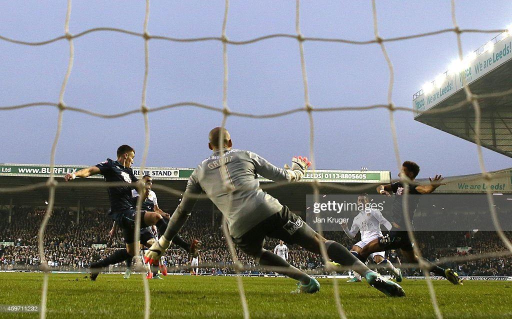 Mirco Antenucci of Leeds(2ndR) shoots past Lee Grant, Goalkeeper of Derby County for the opening goal during the Sky Bet Championship match between Leeds United and Derby County at Elland Road on November 29, 2014 in Leeds, England.