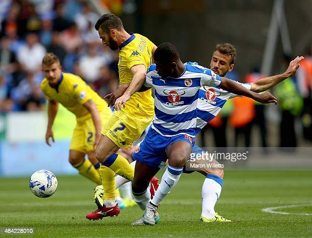 Mirco Antenucci of Leeds United battles for the ball with Aaron Tshibola and Orlando Sa of Reading during the Sky Bet Championship match between...