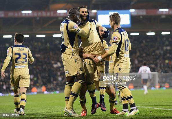 Mirco Antenucci of Leeds United celebrates with team mates as he scores their third goal during the Sky Bet Championship match between Fulham and...