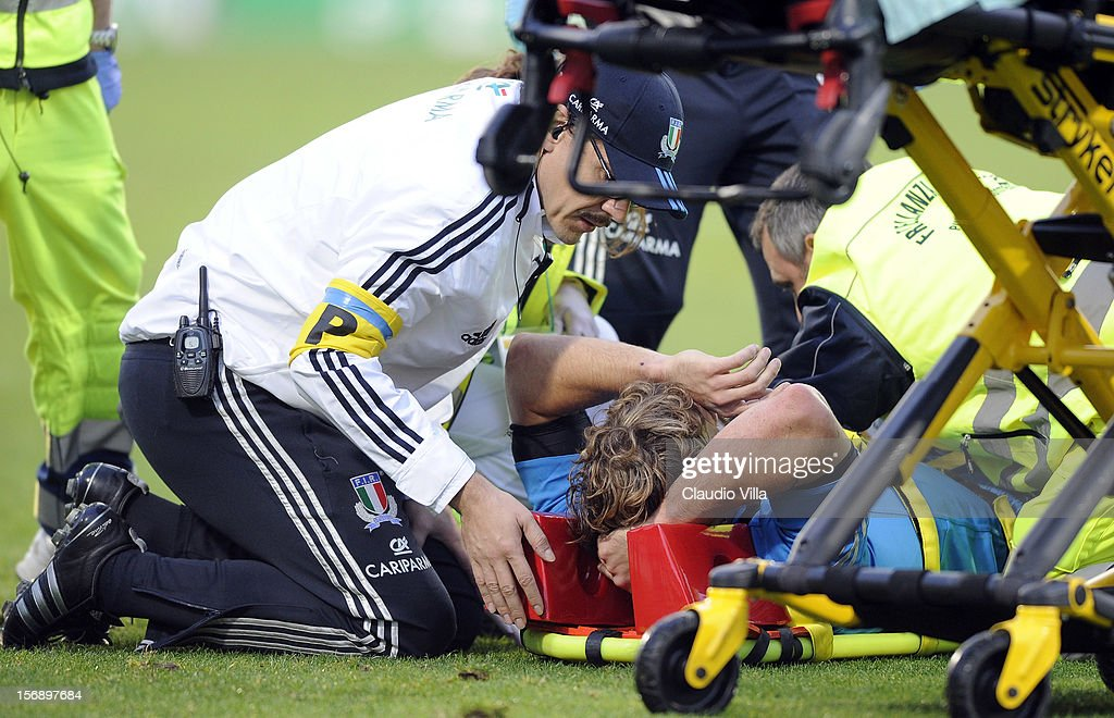 Mirco Bergamasco of Italy receives treatment for an injury during the international rugby test match between Italy and Australia at Artemio Franchi on November 24, 2012 in Florence, Italy.