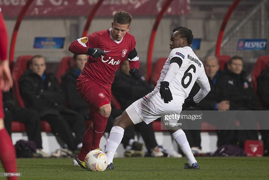 Mirco Born of FC Twente, May Mahlangu of Helsingborgs IF during the Europa League match between FC Twente and Helsingborgs IF at the Grolsch Veste on December 6, 2012 in Enschede, The Netherlands.