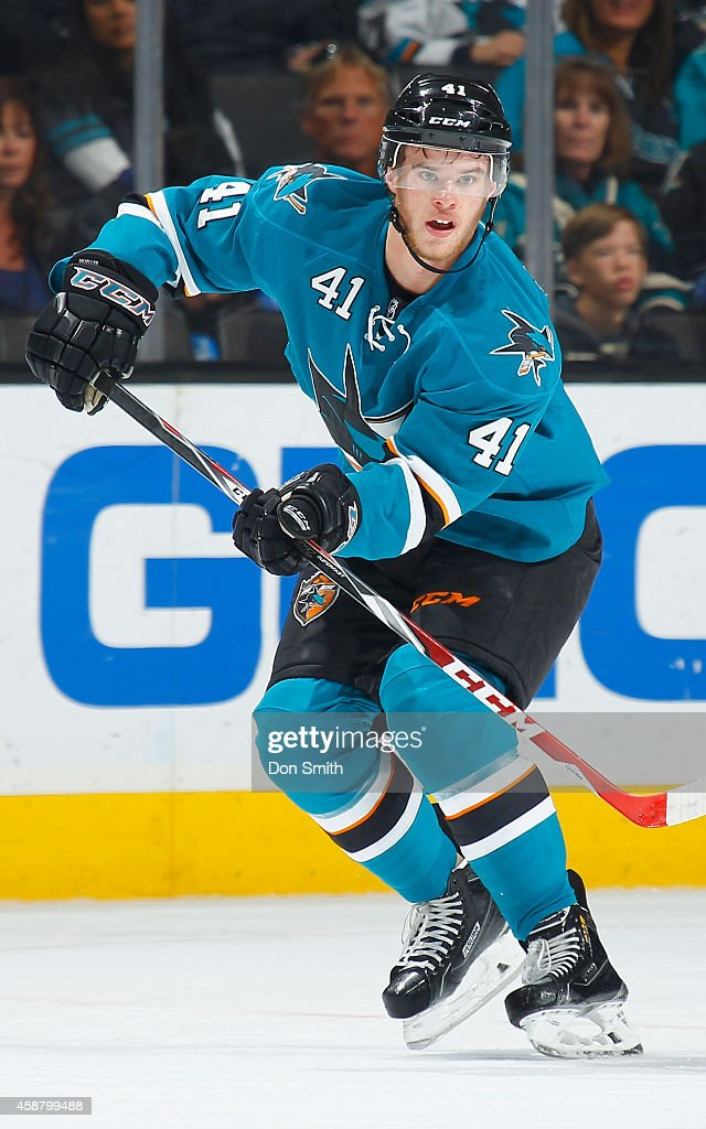Mirco Mueller #41 of the San Jose Sharks passes the puck against the New York Islanders during an NHL game on November 1, 2014 at SAP Center in San Jose, California.