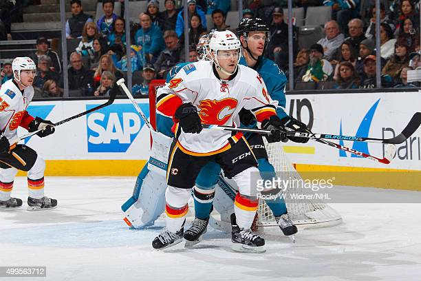 Mirco Mueller of the San Jose Sharks protects the net against Jiri Hudler of the Calgary Flames at SAP Center on November 28 2015 in San Jose...