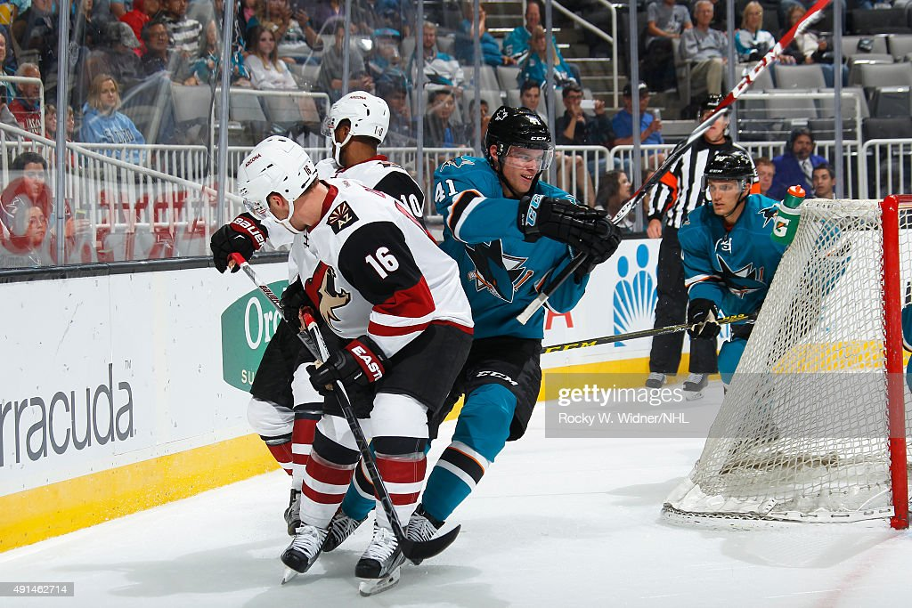 Mirco Mueller #41 of the San Jose Sharks skates against Max Domi #16 and Anthony Duclair #10 of the Arizona Coyotes at SAP Center on September 25, 2015 in San Jose, California.