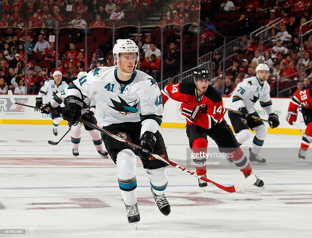 Mirco Mueller #41 of the San Jose Sharks skates against the New Jersey Devils at the Prudential Center on October 18, 2014 in Newark, New Jersey. The Sharks defeated the Devils 4-2.