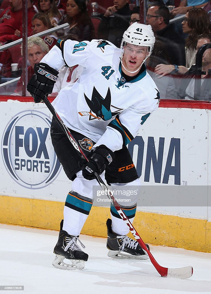 Mirco Mueller #41 of the San Jose Sharks skates with the puck during the preseason NHL game against the Arizona Coyotes at Gila River Arena on October 3, 2014 in Glendale, Arizona. The Sharks defeated the Coyotes 3-1.