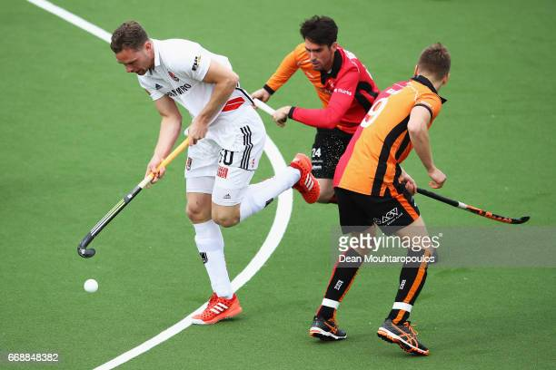 Mirco Pruijser of AH BC Amsterdam gets past the tackle from Jelle Galema and Robert Van Der Horst of HC OranjeRood during the Euro Hockey League KO16...