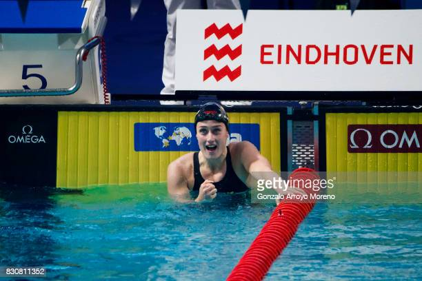 Mireia Belmonte from Spain celebrates after winning and achieving a new record in the Women's 400m Individual Medley Final of the FINA/airweave...