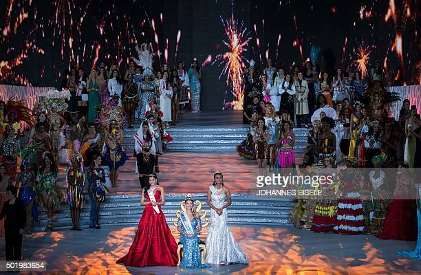 Mireia Lalaguna of Spain poses after winning the new title at the Miss World Grand Final in Sanya next to Miss Russia Sofia Nikitchuk and Miss World...